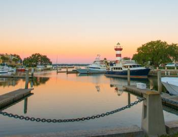 A view of a Hilton Head marina at sunset
