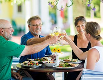 Two Couples Dining on an outdoor Patio