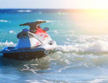 A jet skis sits on the water before a tour