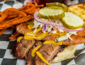 Open faced sandwich with sweet potato fries