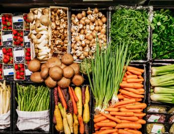 Produce is on the stands of a local market