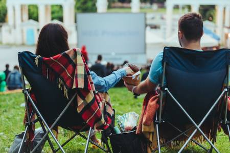 couple watching movie in park