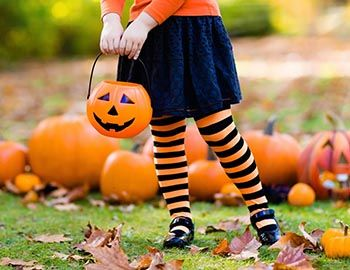 Girl in Halloween Tights in Pumpkin Patch