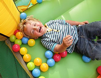 Young boy smiling in bounce house