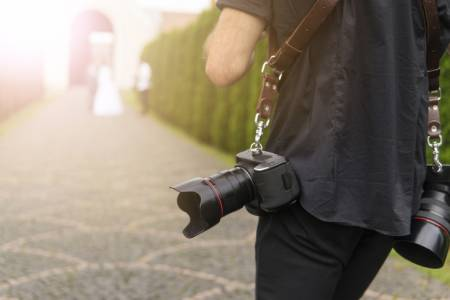 A wedding photographer with his gear