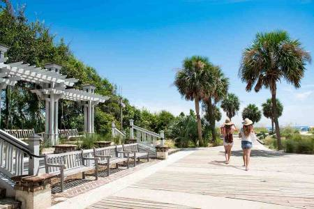Friends walking to the beach at Coligny Plaza