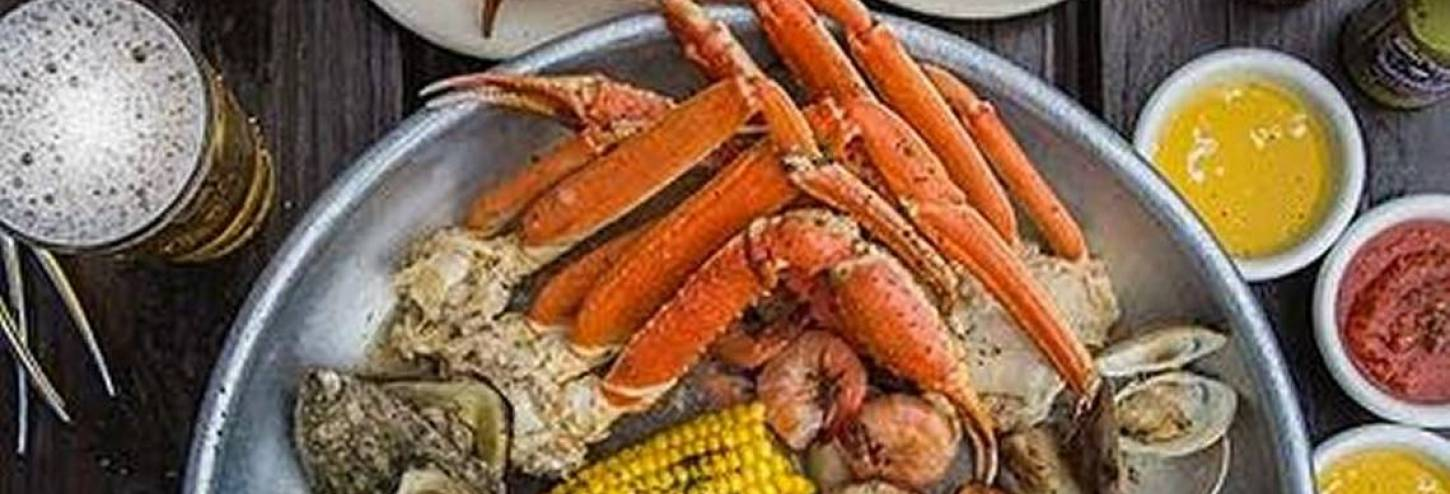 Crab legs, corn and seafood