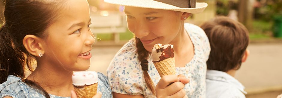 Girls eating ice cream outside
