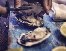 Oyster being cut open