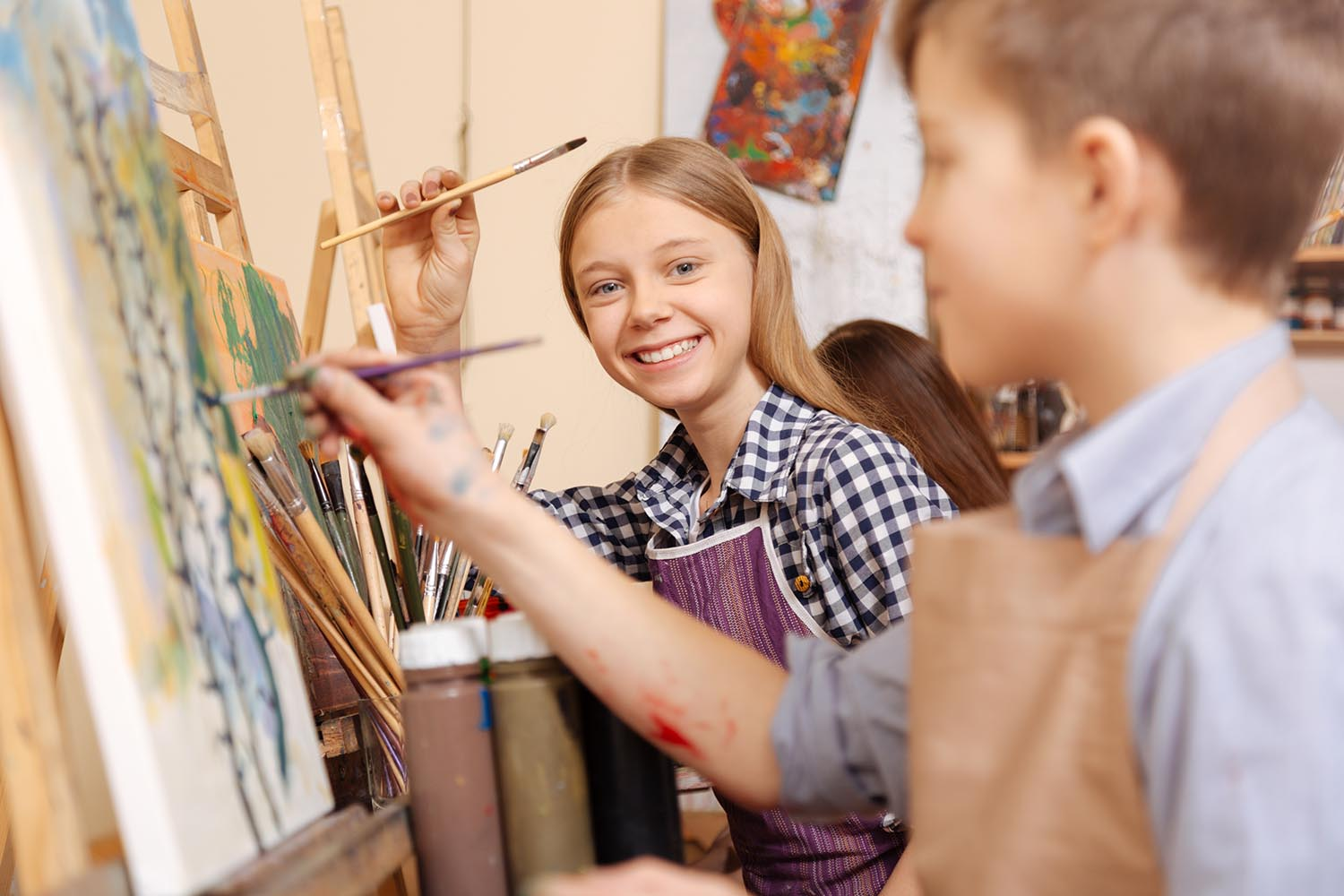 Kids paint in an art class