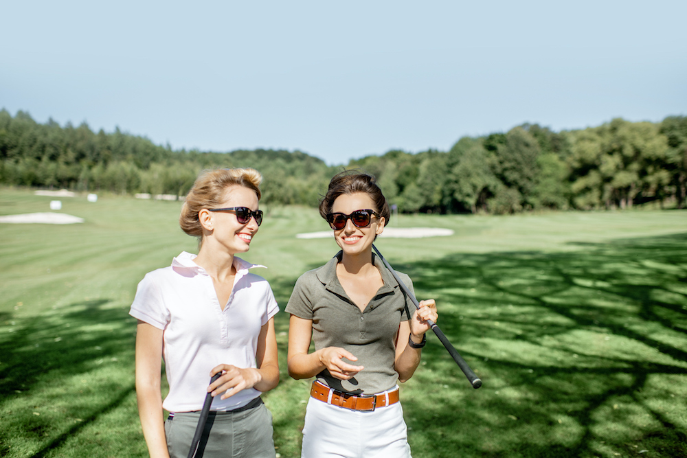 Two women enjoy a round of golf