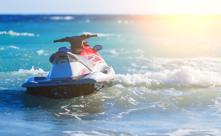 A jet ski sits on the water before a tour