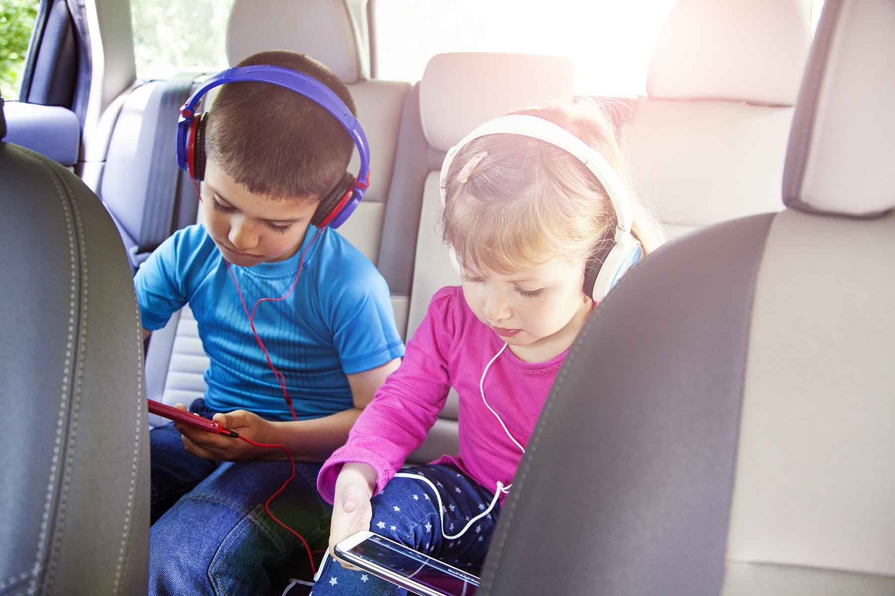 Kids playing games in the car