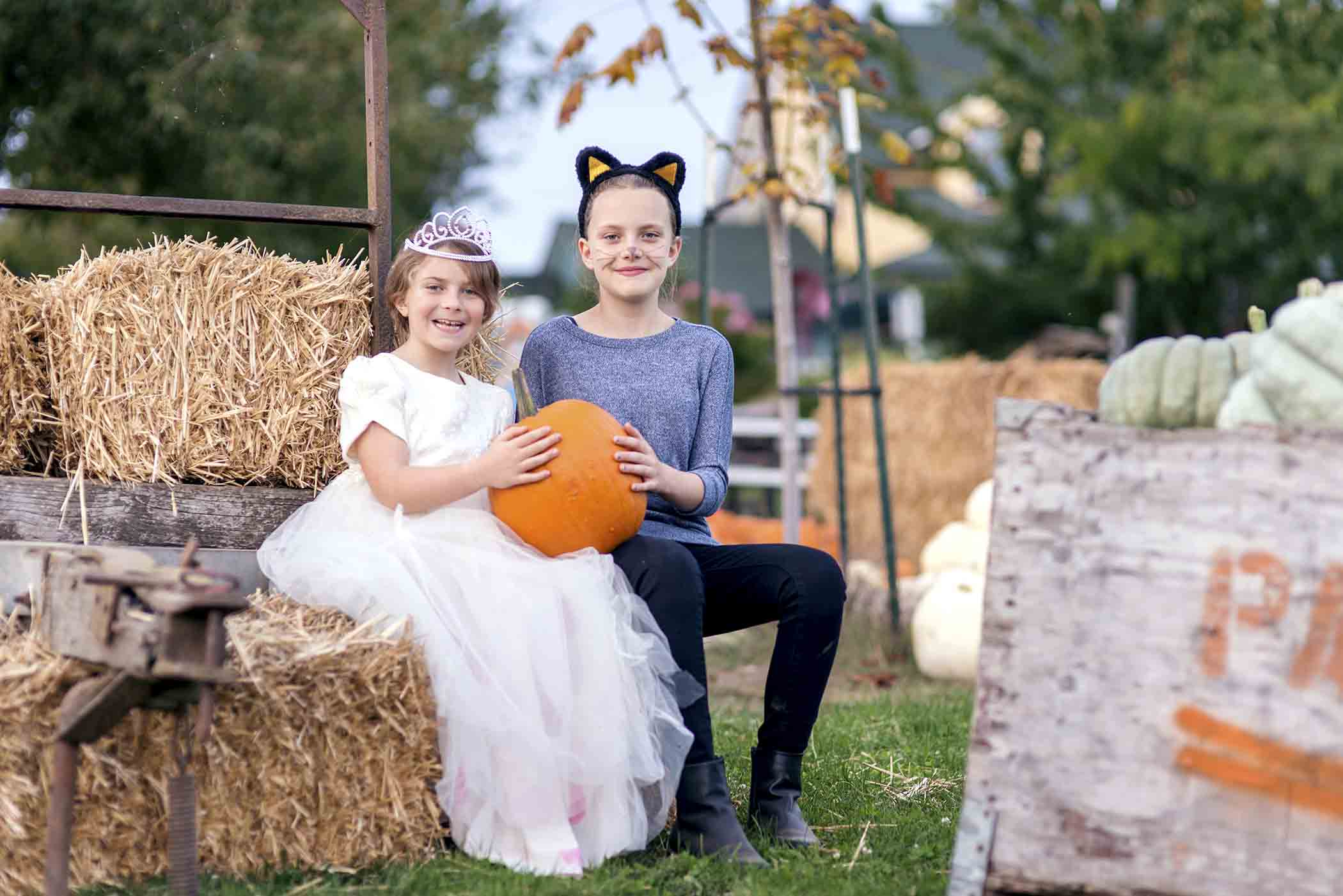Two girls at the pumpkin patch