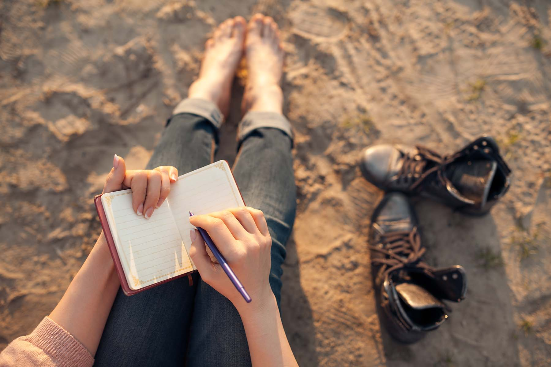 Girl journaling in a book at the beach on Hilton Head