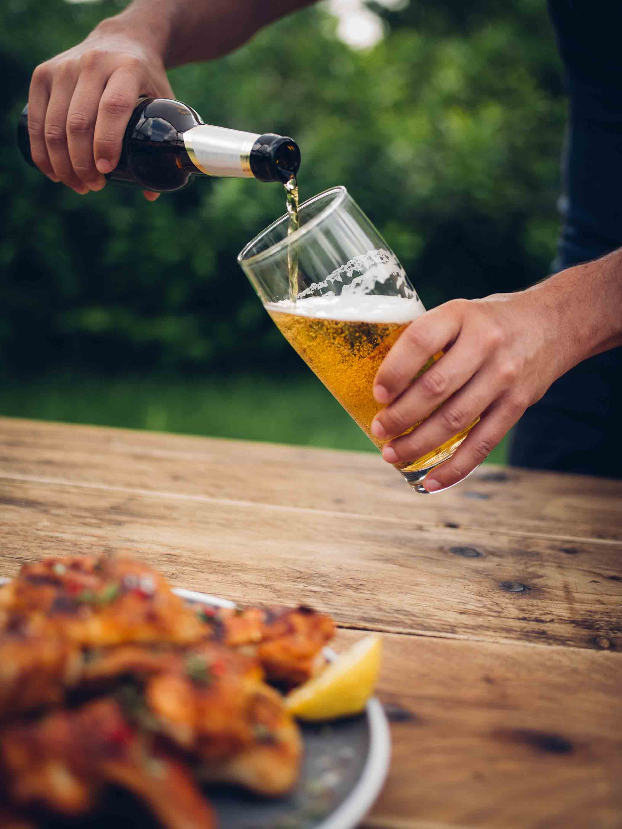 Pouring beer at a wing festival