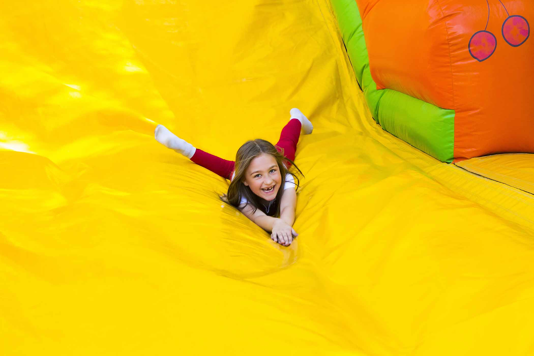 Kid sliding down bouncy house