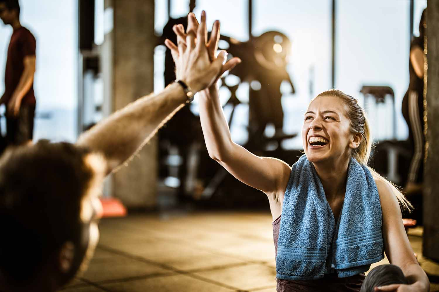Woman giving a high five at the gym